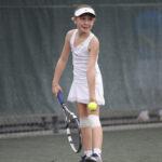Dasha P playing tennis